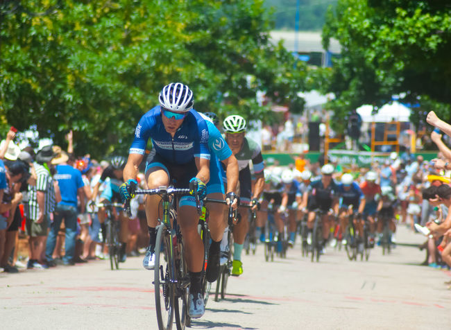 """Tulsa Tough 2018 on Crybaby Hill. This grueling course will test even the fittest racers. Running along the scenic Arkansas River distinguishes """"Tulsa Tough"""". Criterium Bicycle Bicycles Critical Mass Day Headwear Helmet Lifestyles Men Outdoors Pelaton Race Real People Sport"""