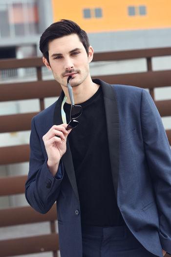 a08de5c810 Portrait of an attractive young businessman outdoors