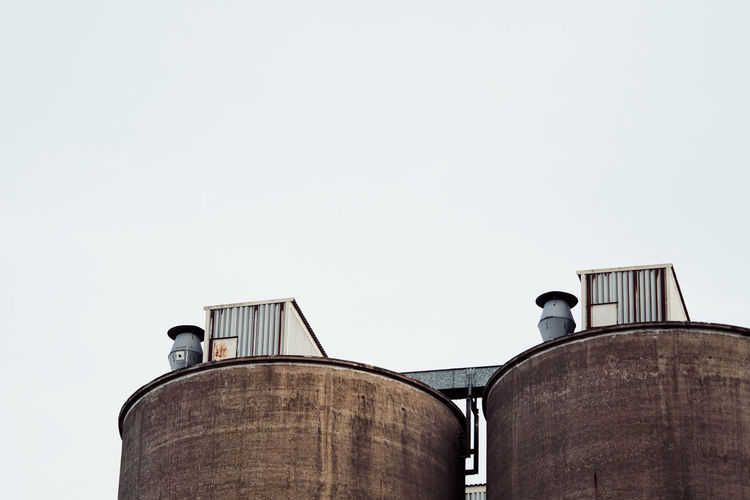 Low Angle View Of Silos