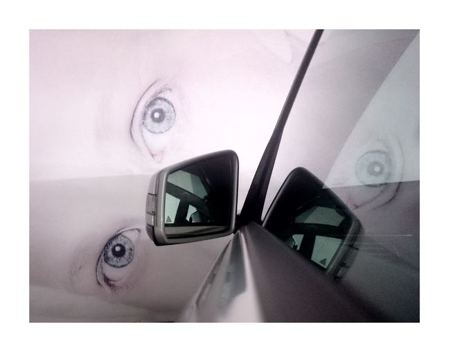 Look into the mirror Surface Level No People Just Taking Pictures Travel Photography Taking Photos Reflection Eye Eyes Are Soul Reflection Walking Around Parking Car Mirror City Urban Streetart Simplicity Noedited Close-up Nolayers Indoors  Tourism