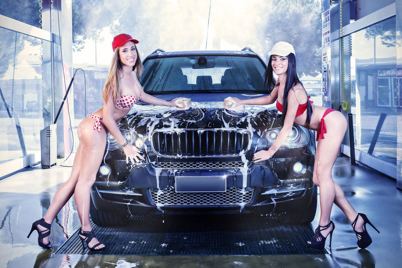 Girls in bathing suits, a car wash by hand with sponge and foam. CarWashTime Pinup Adult Automobile Industry Beautiful People Beautiful Woman Blond Hair Brunette Girl  Car Carwash Carwashing Cheerful Day Full Length Happiness Looking At Camera Only Women Outdoors Portrait Real People Smiling Transportation Women Young Adult Young Women