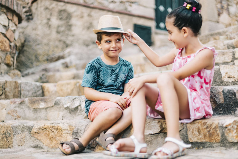 Cute sibling sitting on staircase