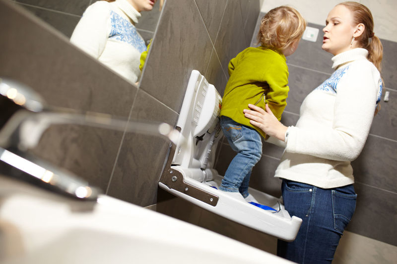 Mother and son in bathroom at home