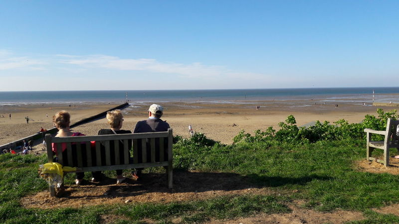 Sea Beach Women Horizon Over Water Senior Adult Adults Only People Togetherness Travel Destinations Outdoors Beauty In Nature Day Sky Grassy Bank Sunny Day