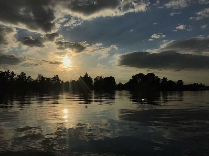 A romantic boat trip Happiness No Edit/no Filter No Filter, No Edit, Just Photography Reflection Water Sky Tree Reflection Cloud - Sky Sunset Tranquility Scenics - Nature Nature Beauty In Nature No People Sunlight Silhouette Lake Non-urban Scene