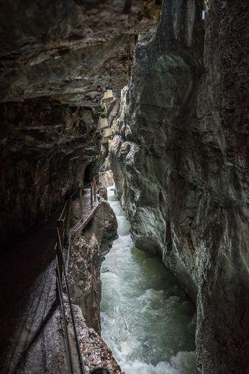Narrow stream along rock formation
