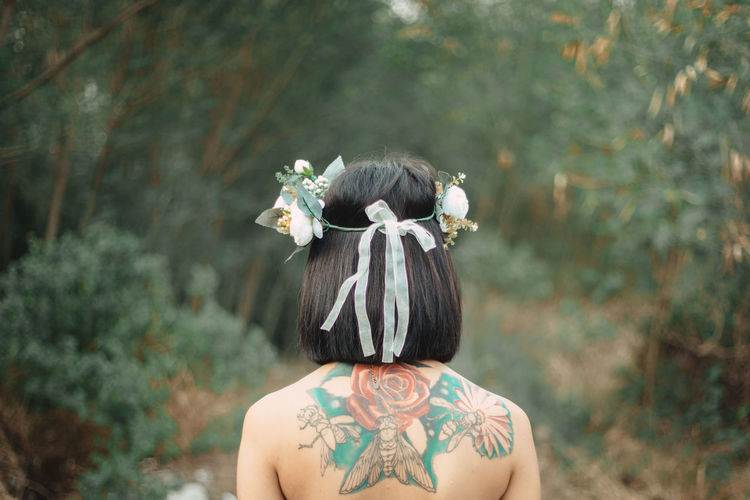 Adult Day Flower Flower Head Flowering Plant Focus On Foreground Hair Hairstyle Headshot Land Leisure Activity Lifestyles Nature One Person Outdoors Plant Real People Rear View Tree Wearing Flowers Women