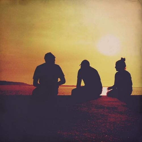 Three friends on the sunset talking about the iPhoneography Silhouette Shadow Sun_collection Sunset