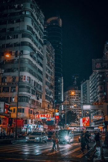 Illuminated city buildings at night