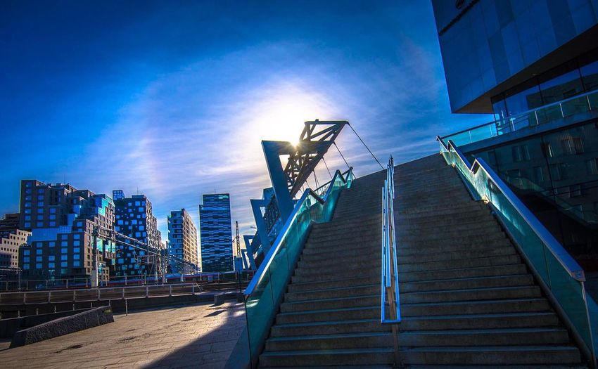 Staircase in city against sky