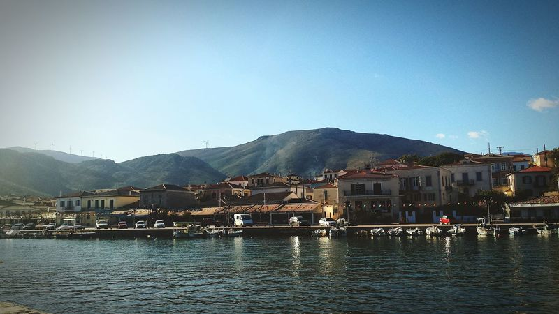 Water Reflections Sea And Sky Sea Houses Outdoors Sky Mountain Galaxidi Greece Harbourside
