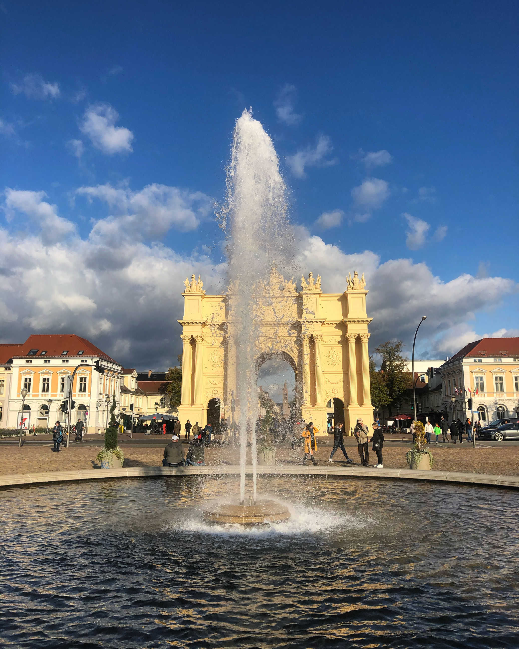 architecture, built structure, building exterior, water, sky, fountain, cloud - sky, city, nature, spraying, travel destinations, travel, building, motion, tourism, waterfront, day, incidental people, outdoors