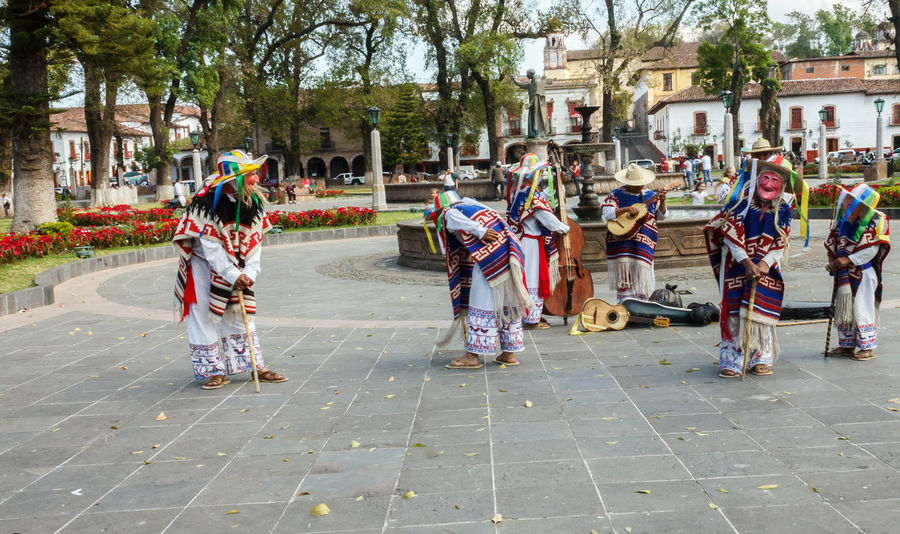 """""""Dance of the little old men"""" in Patzcuaro, Michoacan, Mexico Actor City City Life City Street D Dancing Day Enjoyment Full Length Group Of People Large Group Of People Leisure Activity Lifestyles Little Old Lady M Men Outdoors Patzcuaro Performance Traditional"""