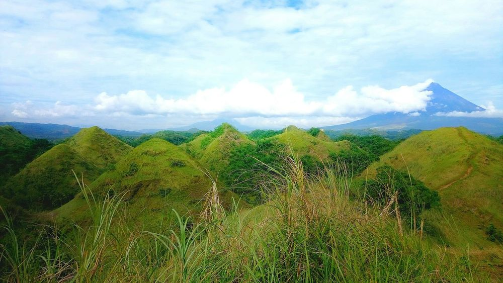 It looks like the Chocolate Hills in Bohol can also be found in Albay with the Mayon Volcano Sky Nature Beauty In Nature Outdoors Travel Travel Photography Nature Eyeem Philippines Bicolandia Philippines Bicol, Philippines Sony Xperia Photography Sony Xperia C5 Photography Vacations Backgrounds Clouds And Sky Rural Scene Mountain Scenics Travel Destinations Vacation Landscape
