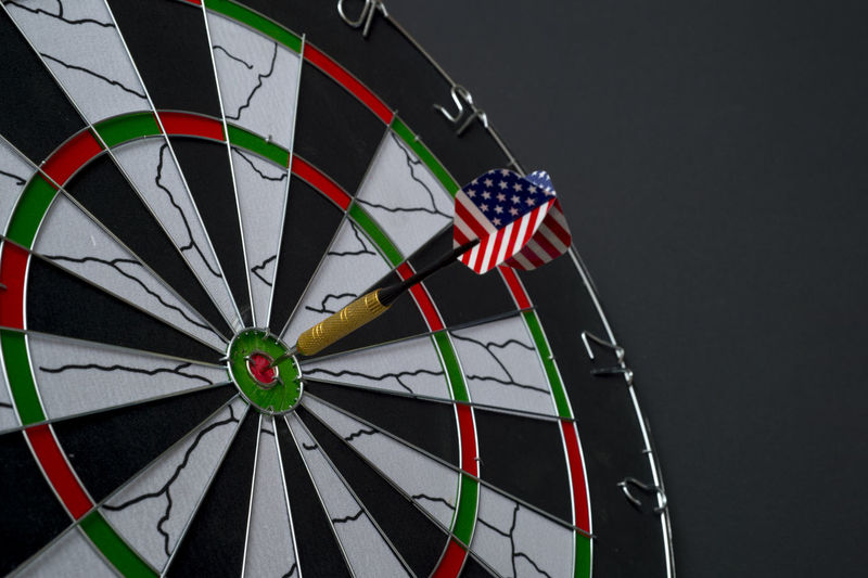 Center target of darts isolated on a black background Dartboard Bulls-eye Win Successful Center Public Metaphor Point Result Dart Targeting Victory Black Sport Board Mark Perfection Strategy Relations Conceptual Target Marketing Challenge Media Isolated American Circles Red Hit White Accuracy Objects Luck Accurate Perfect Arrow Patterns Ideas Game Flag Concept Direct Bull Success Eye Market Winner Background Play Sports Target No People Pattern Shape Circle Geometric Shape Studio Shot Indoors  Close-up Striped Patriotism Gray Still Life Gray Background
