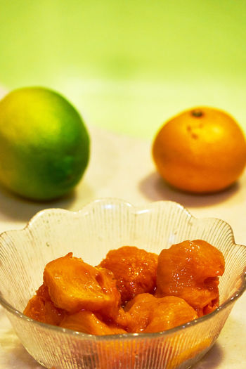 Freshness Orange Persimmon Fruits Apple - Fruit Breakfast Close-up Day Dessert Food Food And Drink Freshness Fruit Fruits Healthy Eating Indoors  Lemon Lime Green No People Plate Ready-to-eat SLICE Still Life Sweet Food Table White Background