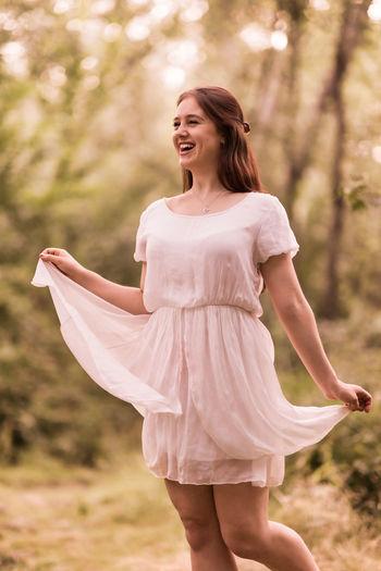 Happy woman standing on field