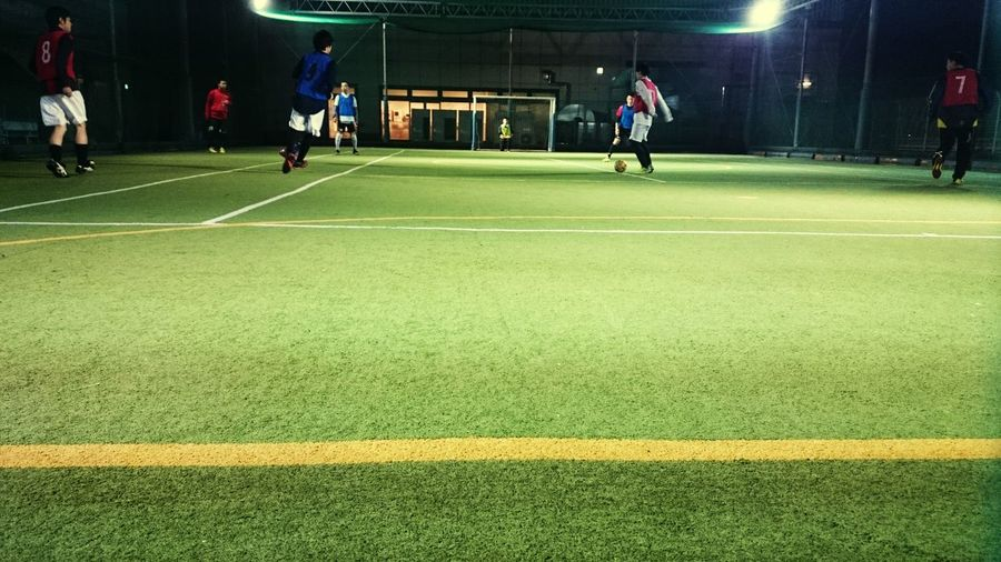 Players playing indoor soccer