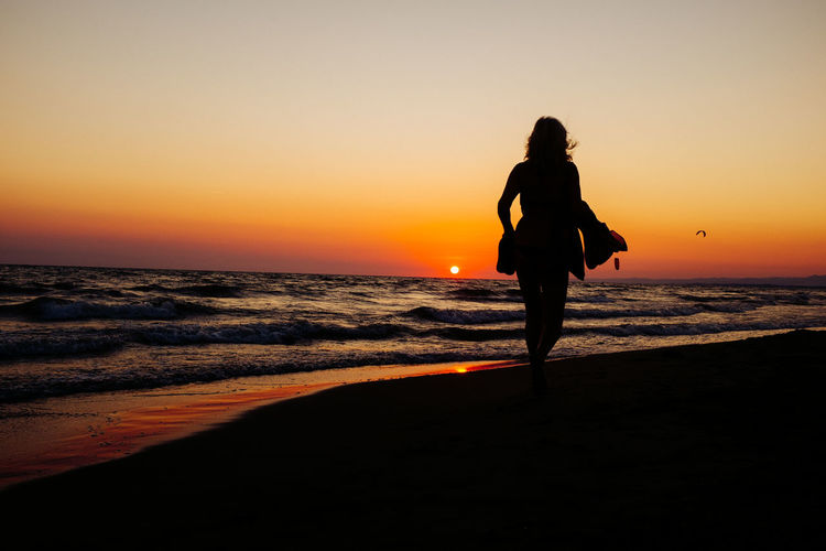 Lighting my way Beach Beauty In Nature Coastline Full Length Horizon Over Water Idyllic Leisure Activity Lifestyles Nature Orange Color Outdoors Remote Scenics Sea Shore Showcase May Sky Standing Sun Sunset Tranquil Scene Tranquility Vacations Water The Great Outdoors - 2016 EyeEm Awards