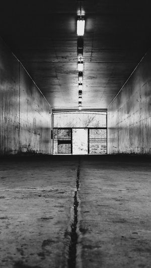 See you on the other side EyeEm Selects City Urban Urban Tunnel View Black And White Blackandwhite Photography Black & White San Diego California Eunoialux Tunnel Light At The End Of The Tunnel Underpass Underground Ceiling Electric Light Underground Walkway
