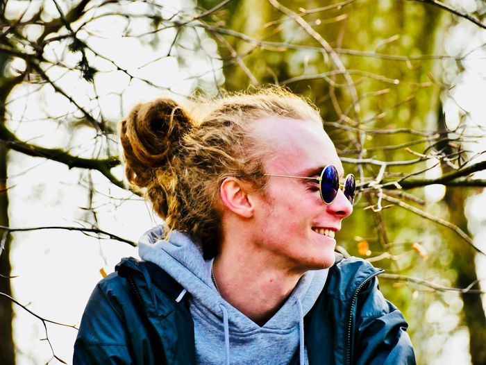 Headshot One Person Real People Portrait Lifestyles Leisure Activity Plant Young Adult Tree Glasses Day Fashion Sunglasses Nature Front View Looking Away Looking Focus On Foreground Smiling Outdoors