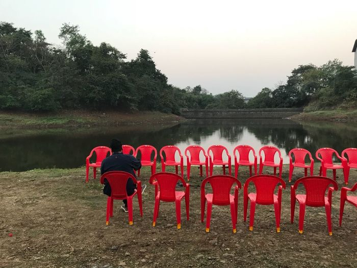 Nature Man Chair Red Greenery Virginphotosmumbai