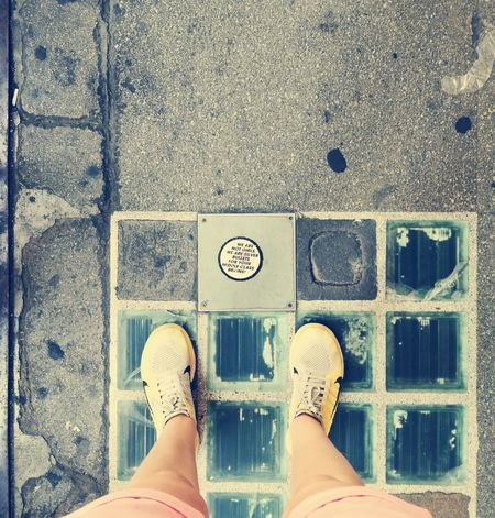 Middle Class Silver Bullet Girls Low Section Standing Human Leg Directly Above Manhole  Sewage Shoe Personal Perspective Sewer Footwear Ground Human Feet Asphalt Metal Grate Road Marking