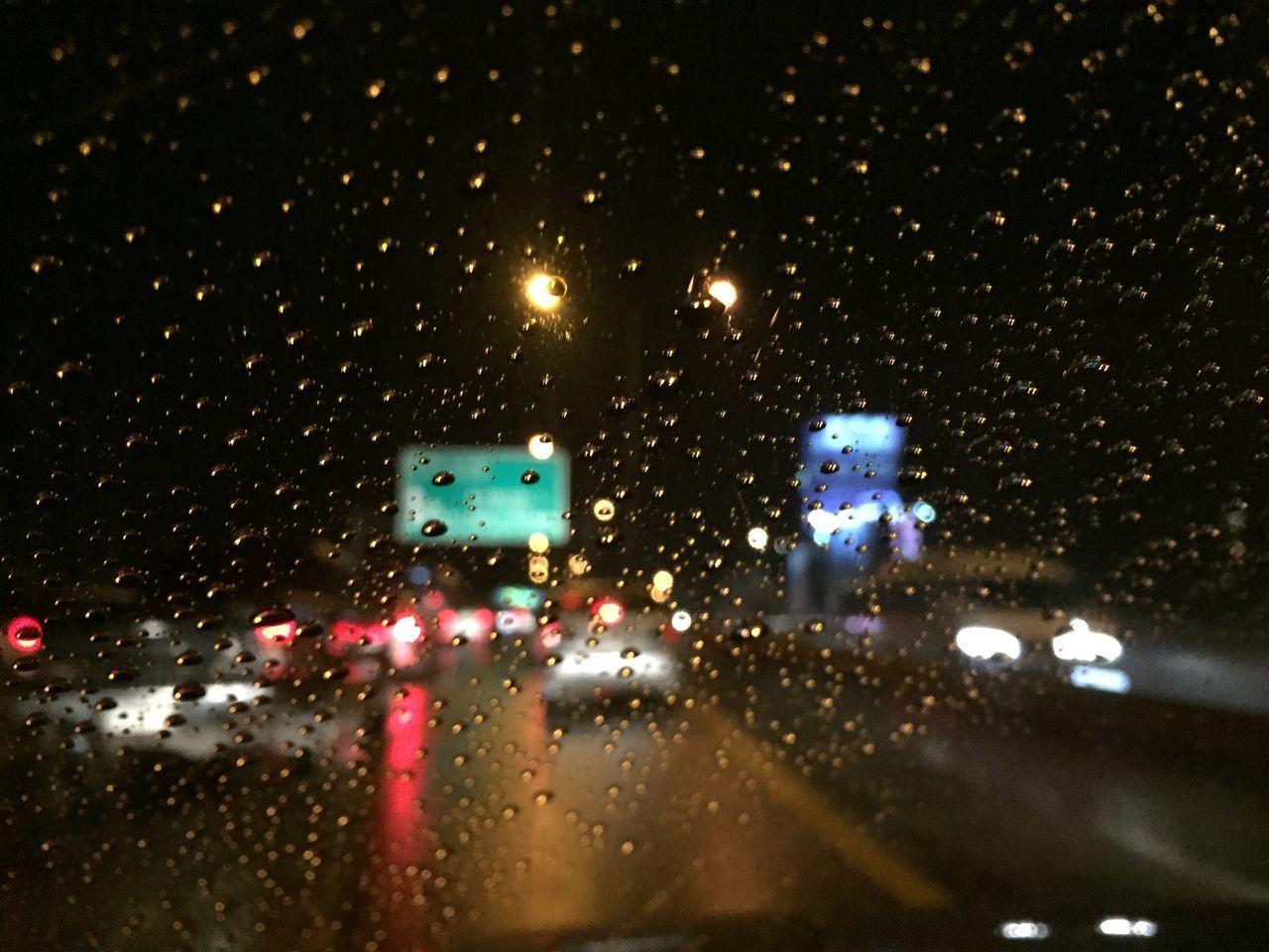 illuminated, night, rain, raindrop, weather, transportation, wet, rainy season, no people, drop, land vehicle, window, car, outdoors, city, water, architecture, close-up, sky