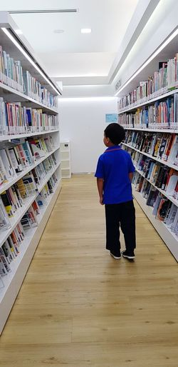 Books Heaven Library Book Bookworm Blue Young Boy Ideas Are Everywhere Knowledge Is Power Bookshelf Library Full Length Shelf Choice Rear View