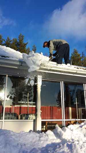 Care Man Roof Building Exterior Cnow Cleaning Cold Temperature Danger Day Full Length Leisure Activity Men Nature One Person Outdoors Real People Sky Snow Standing Winter