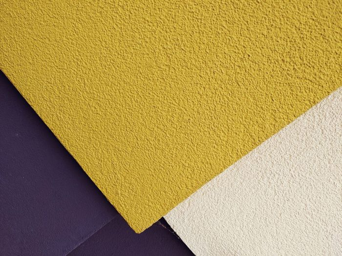 High angle view of yellow paper on wall