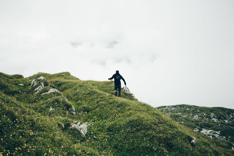 Man Walking On Mountain Against Sky