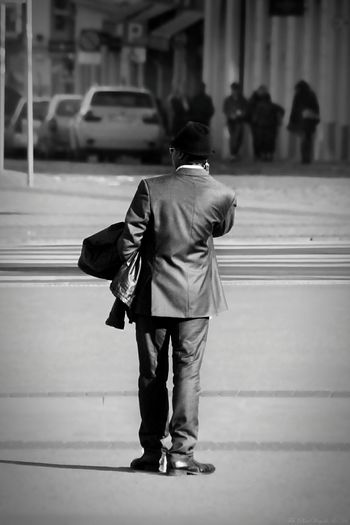 Rear View Of Businessman Standing On City Street