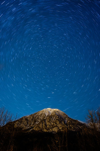 Astronomy Astrophotography Blue Long Exposure Low Angle View Mountain Nature Night No People Sky Space Star - Space Star Field Star Trail Tranquility
