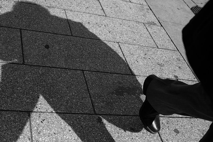 Adult Walking Black And White Blackandwhite Canon City Day Human Body Part Human Foot Human Leg Lifestyles Light And Shadow Low Section Men One Man Only One Person Only Men Outdoors People Real People Shadow Shoe Standing Stone Tile Street