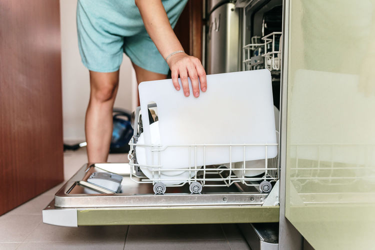 Midsection of woman working at home
