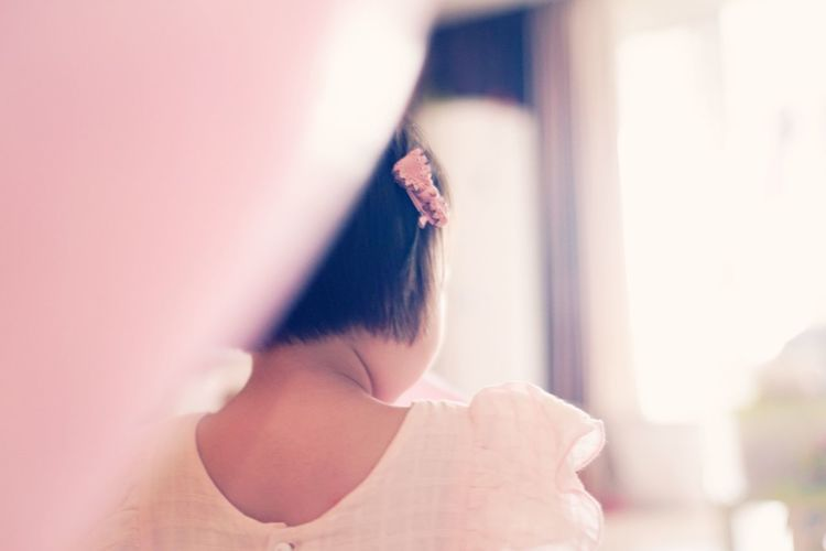 Close-up of woman with hand on hair
