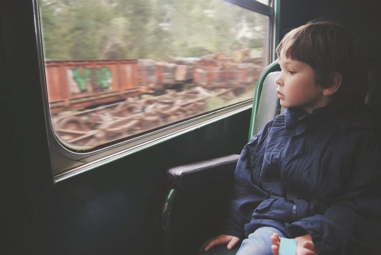 Childhood Train Looking Out Of The Window Child Boy Little Young Serious Face Peaceful