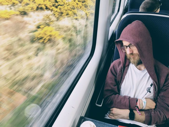 EyeEm Selects Beard Window Sitting Transportation Journey Mode Of Transport Travel One Man Only One Person Only Men Looking Through Window Reflection Train - Vehicle Casual Clothing Men Adult Adults Only People Day Outdoors