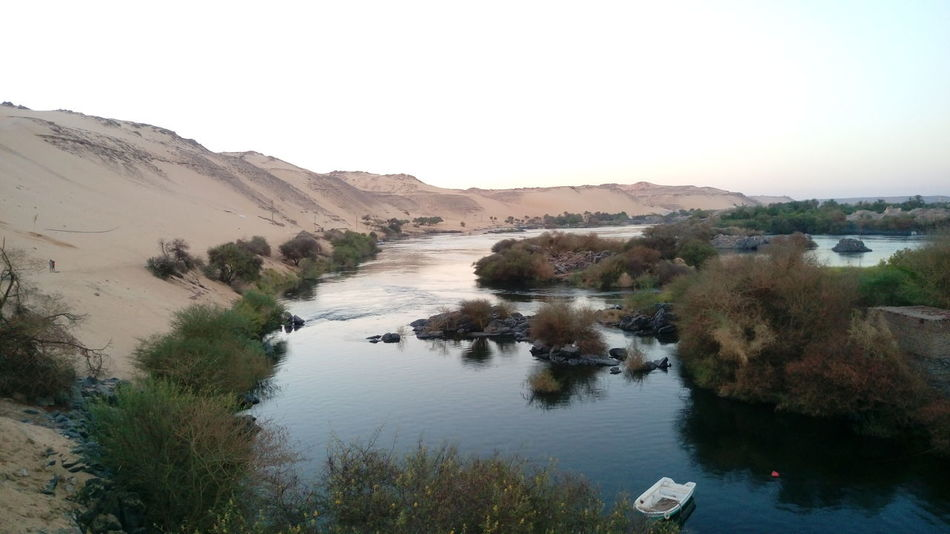 Aswan, Egypt Aswan Aswan Egypt From My Point Of View Sailing Nile Summer Feel The Journey Beautiful Nature Hill Nubia Nubian Village Egypt Mountain River Nature's Diversities Beauty In Nature Nile River Water Clear Sky Boat Sailboat Showcase June
