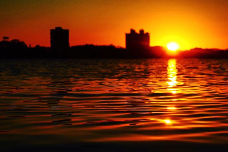 Fresh on Market 2017 Sea Sunset Water No People Beach Orange Color Reflection Focus On Foreground Rippled Outdoors Scenics Sky Tranquil Scene Travel Cityscape Contrast Gold Waterfront EyeEmBestPics EyeEm Best Shots EyeEm Gallery EyeEm Best Edits Light Silhouette