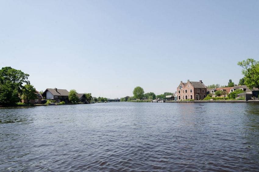 Abcoude, Amstel River, Amsterdam, Netherlands by water in the canals Amsterdam Amsterdam Canal Amsterdam City Dogs Abcoude Amsterdamcity Amsterdamse Grachten Boat Boats Day Dog Nature Oude Kerk Sky Water Waterfront