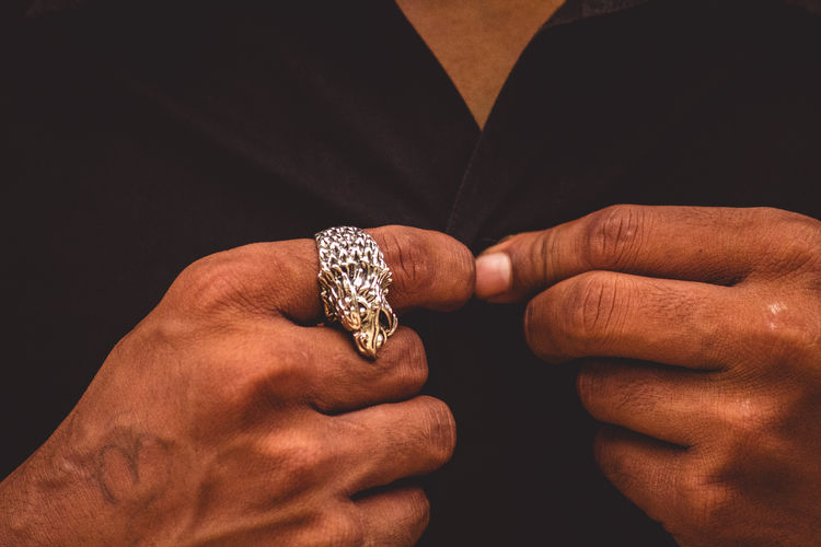 Adult Black Background Body Part Close-up Diamond - Gemstone Finger Hand Holding Human Body Part Human Hand Indoors  Jewelry Luxury Men Midsection One Person Personal Accessory Real People Ring Studio Shot Wealth