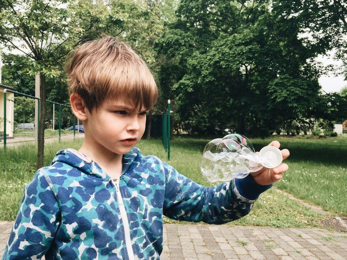 Boy playing with bubble blower