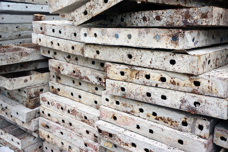 Molds used to make the cement floor, after use be put together. Compression Concrete Construction Site Cube Engineer Iron Lmould Testing Worker No People Metal Stack Old Close-up Hole