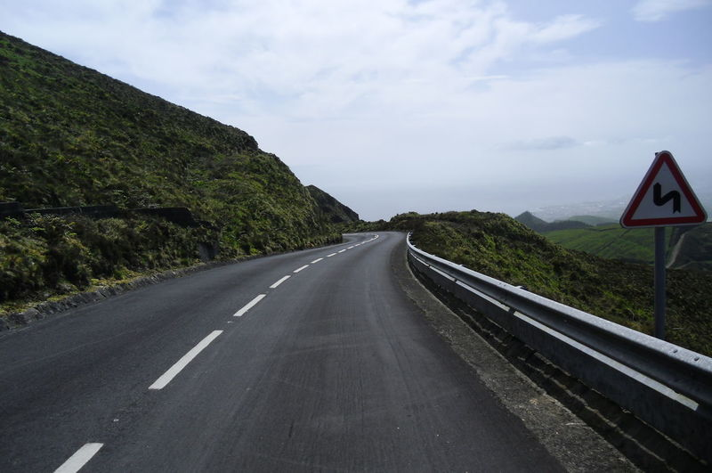 Asphalt Cloud - Sky Country Road Diminishing Perspective Dividing Line Double Yellow Line Empty Empty Road Highway Mountain Nature Road Road Marking Road Sign Sky Street The Way Forward Transportation Tree Vanishing Point Travel Destinations Thegreatoutdoorswithadobe