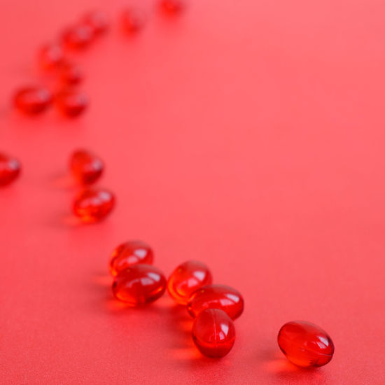 High angle view of pills on red background
