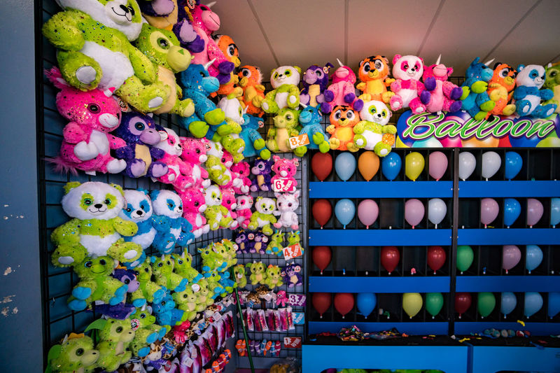 Fun Prizes Ballons Games Abundance Amusement Park Arrangement Business Choice Collection Consumerism In A Row Indoors  Large Group Of Objects Multi Colored Order Sale Shelf Small Business Stuffed Animals Toy Variation