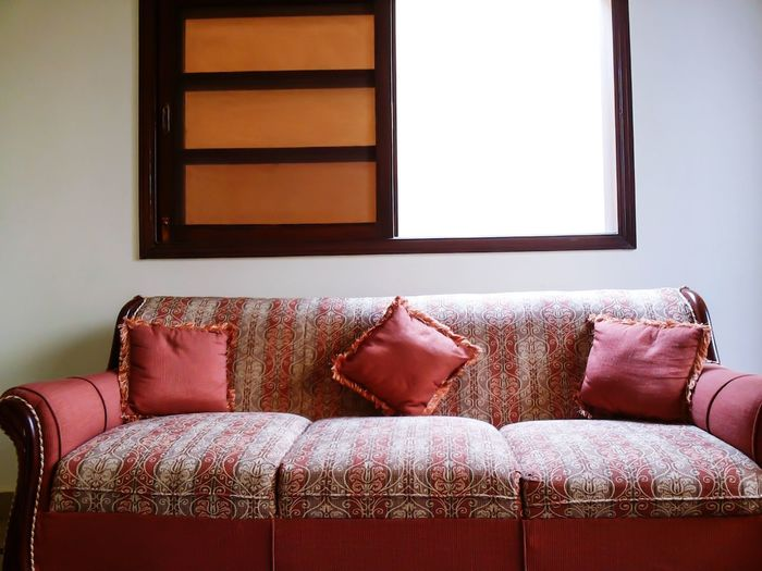 Red couch by window