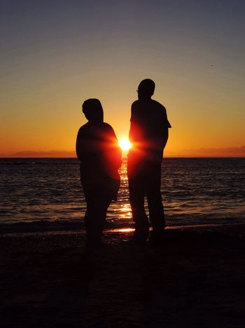 Connected Silhouette Couple Sunset Beach UNPOSED Outdoors Watching The Sunset Sea Water Sand Shore